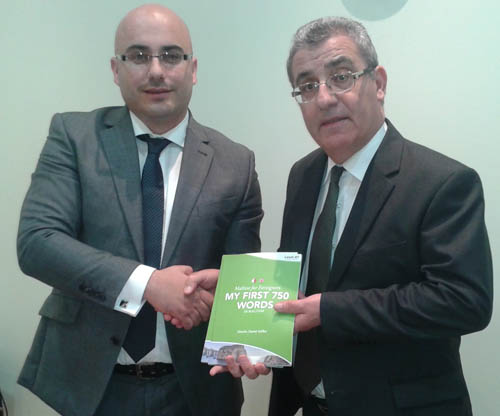 Charles Daniel Saliba Presenting Foreign Series books to Minister Evarist Bartolo