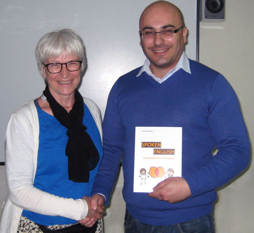 Dr Sussanne Jørgensen presenting Charles Daniel Saliba with her book, Spoken English: Communication Strategies.