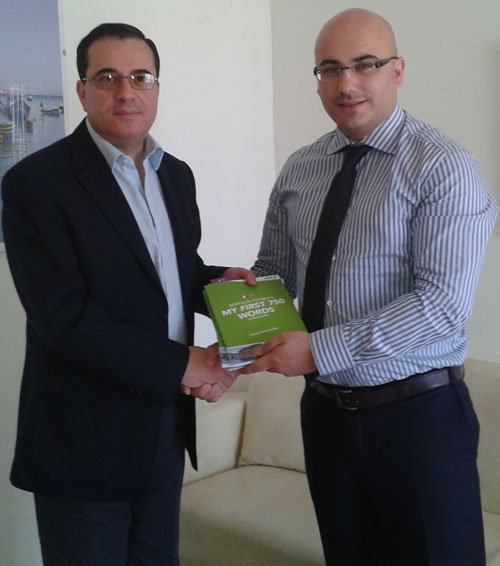 Charles Daniel Saliba Presenting Foreign Series books to Permanent Delegate to UNESCO Mgr Dr Joe Vella Gauci