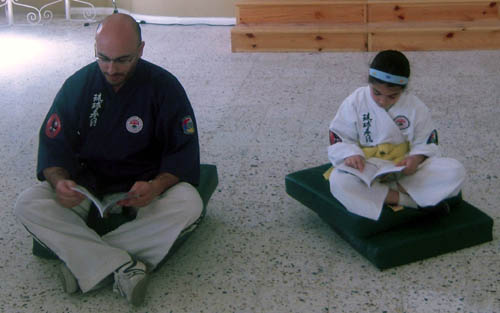 Sensei Charles Daniel Saliba reading -Rocco jitghallem il-karate- together with Antonella Vella-Muskat